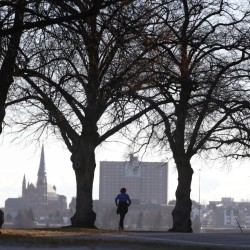 A jogger runs along the Back Cove trail in Portland in December. Health rankings in southern coastal Maine are particularly favorable compared to the national median – but the same isn't true for the state's rural counties.