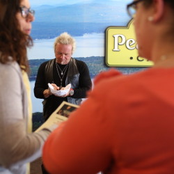 "Joey Kramer signs autographs at Saint Joseph's College of Maine in Standish on Thursday. The Aerosmith drummer was there to promote his ""Rockin' & Roastin'"" organic coffee brand."