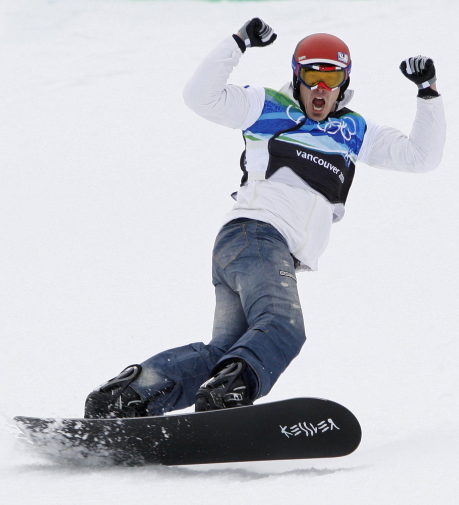 Seth Wescott celebrates after crossing the finish line to win the gold medal in snowboardcross on Cypress Mountain at the Vancouver Winter Olympics in 2010. Reuters photo