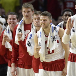 Wisconsin players start the fist-pumping on the bench near the end of the Badgers' win over North Carolina, which earned them a spot in the Elite Eight.