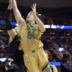 Pat Connaughton of Notre Dame heads to the basket against Ron Baker of Wichita State during the first half of their NCAA basketball tournament game Thursday night. The Irish rolled into the Elite Eight, pulling away for an 81-70 victory at Cleveland.