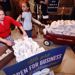 Five-year-old Patience, daughter of Angie and Cynthia Alexander (not shown), was recruited by Freedom Indiana to deliver wagons of protest letters to some lawmakers.