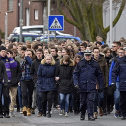 Students arrive for a memorial service Friday in Haltern, Germany. Sixteen students and two teachers from Haltern were among the 150 victims of a Germanwings plane crash in the French Alps on Tuesday.   The Associated Press