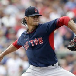 Clay Buchholz, lined up to pitch Boston's season opener, gave up 12 hits and four runs in five-plus innings Friday in a 4-2 loss to the Braves in Kissimmee, Fla.
