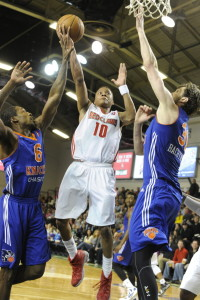Maine point guard Tim Frazier goes up with a shot between Westchester Knicks defenders Durrell Summers, left, and Jordan Bachynski during the Red Claws' 102-94 win Friday in Portland. John Ewing/Staff Photographer