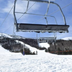Chairs hang in the air at the base of the unused King Pine chairlift this week at the Sugarloaf ski resort. A malfunction of the lift, installed in 1988, had caused the lift to travel backward, injuring seven skiers.