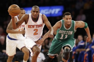 New York Knicks guard Langston Galloway drives to the basket past Celtics guard Evan Turner during the first half of Friday night's game.