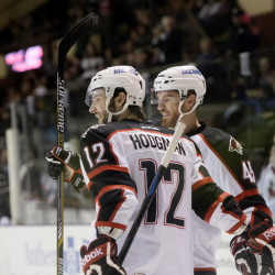 Portland Pirates Justin Hodgman, left, and Alex Bolduc celebrate a second-period goal against the St. John's Icecaps Thursday.  Shawn Patrick Ouellette/Staff Photographer