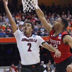 Quentin Snider, who finished with 14 points for Louisville, drives past Ralston Turner of North Carolina State in the first half Friday night.