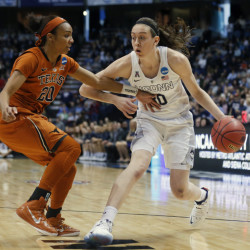 Connecticut forward Breanna Stewart drives against Texas guard Brianna Taylor in Saturday's regional semifinal game in the NCAA tournament on Saturday at in Albany, N.Y. Breanna Stewart had 31 points, 12 rebounds and seven assists as UConn routed Texas, 105-54.