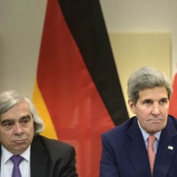 U.S. Secretary of Energy Ernest Moniz, left, and U.S. Secretary of State John Kerry wait for the start of a trilateral meeting in Lausanne, Switzerland, on Saturday.
