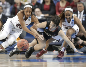 Florida State's Leticia Romero, center, battles South Carolina's Tiffany Mitchell, left, and Asia Dozier, for the ball in the first half of Sunday's Greensboro Regional final at Greensboro, N.C.