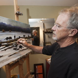 Former defense attorney-turned-Assistant Attorney General John Alsop works in his Cornville home studio on a painting of wild turkeys in a snow-covered field.