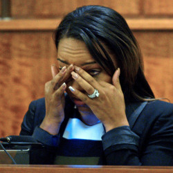 Shayanna Jenkins, fiancee of former Patriots player Aaron Hernandez, cries as she testifies in court during Hernandez's murder trial Monday in Fall River, Mass.