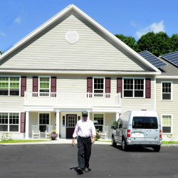 Resident Alan Sawyer Sr. walks out of Brookside Village, a low-income senior housing project in Farmington. Over 9,000 Maine seniors are on a waiting list for affordable, subsidized homes, and their ranks are growing.
