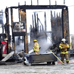 Firefighters put out a blaze that destroyed Ray's Auto in Belgrade on Monday.