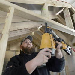 Ryan Richards works on a project at Shed Happens manufacturing yard in Standish.