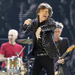 This Feb. 26, 2014 file photo shows Mick Jagger and the Rolling Stones performing during their concert at Tokyo Dome in Tokyo.