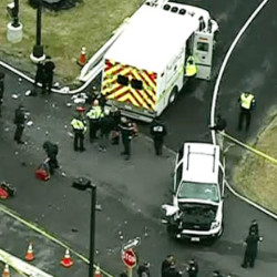 In this image made from video and released by WJLA-TV, authorities investigate the scene of a accident near a gate to Fort Meade, Md., on Monday.