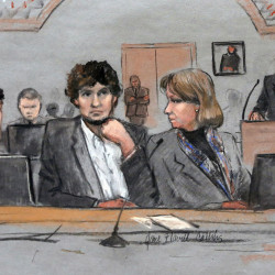 Dzhokhar Tsarnaev, center, is depicted between defense attorneys Miriam Conrad, left, and Judy Clarke, right, during his federal death penalty trial in Boston.