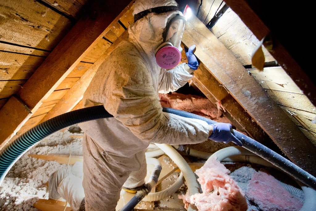 A worker from Evergreen Home Performance blows cellulose insulation into the attic of Jim Johnson's house in Portland on Wednesday. Johnson got the work done with the help of a $2,000 rebate program from Efficiency Maine. The state Public Utilities Commission voted Tuesday to cap the Efficiency Maine Trust's funding at $22 million for the fiscal year beginning in July 2016, rather than the $60 million the Legislature apparently intended.