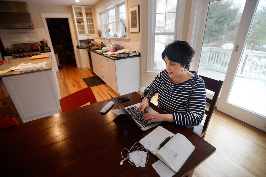 Sara Juli works from her home in Falmouth on Thursday. She and her family moved to Maine from New York last summer. She said they appreciate the space they have while she and her husband maintain their New York careers.