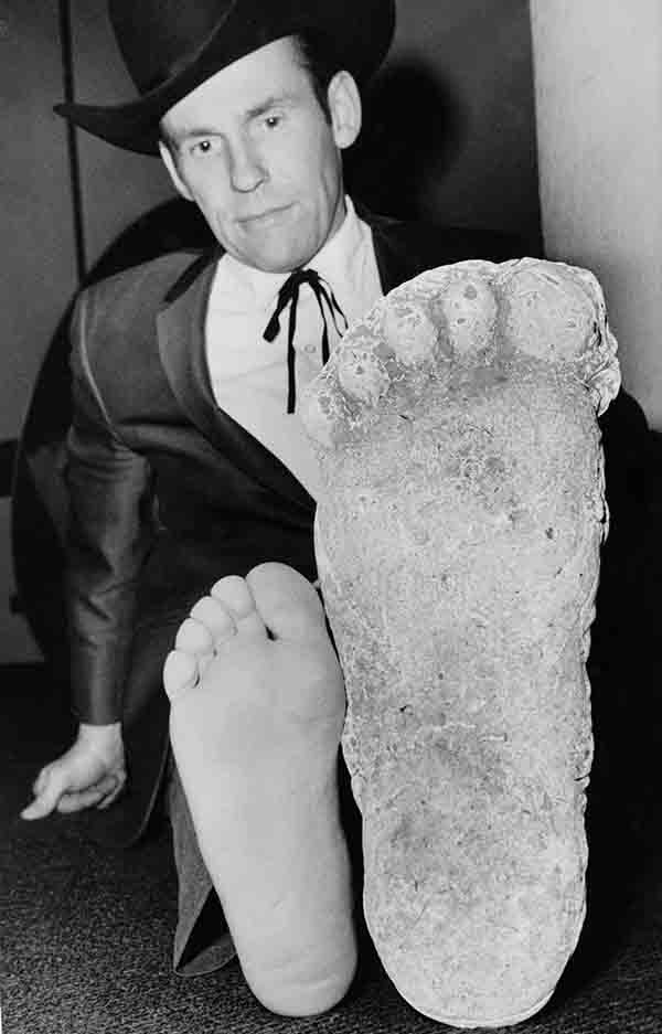 Roger Patterson compares his foot with a cast in Los Angeles on Nov. 3, 1967, that he says he made of California?s Legendary Bigfoot after tracking it in forest country near Eureka, Calif. Patterson says he spotted the hairy, 7-foot-tall creature, and made motion pictures of it from a distance. At the time he said he planned to subdue the beast with tranquilizer guns the next time he located it. The Associated Press