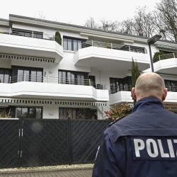 A police officer stands guard at a house In Duesseldorf, Germany, where Andreas Lubitz, the co-pilot of the crashed Germanwings airliner, rented an apartment. The Associated Press