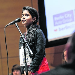 Steffi Victoria, 11, of Sedomocha Middle School and representing Piscataquis County, spells a word during last year's  Maine State Spelling Bee at USM's Hannford Hall.