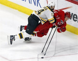 Bruin Adam McQuaid collides with Hurricane Chris Terry during the third period.