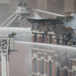 Firefighters spray water on a collapsed building in New York's East Village.