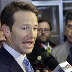 Rep. Aaron Schock speaks to reporters before meetings with constituents in Peoria Ill. in February, 2015.