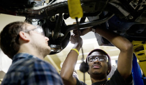 Automotive service technology students work on a car at the Community College of Philadelphia in this October 2014 photo. The National Association for Business Economics has boosted its outlook for U.S. economic improvement in 2015 and 2016, particularly for job growth. The Associated Press