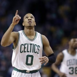 Boston Celtics guard Avery Bradley points upward after scoring against the Miami Heat  in Boston Wednesday. Celtics guard Marcus Smart (36) is in background. (AP Photo/Elise Amendola)