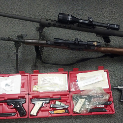 Police display several firearms seized in the investigation of an alleged guns for drugs operation in York County. Photo courtesy of Maine State Police