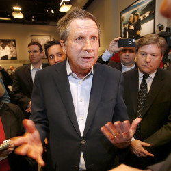 Ohio Gov. John Kasich, R-Ohio, is greeted after speaking at a breakfast hosted by the New Hampshire Institute of Politics at Saint Anselm College  in Manchester, N.H., on Tuesday. The Associated Press