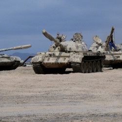 In this photo taken Tuesday, tanks seized by militiamen loyal to Yemen's President Abed Rabbo Mansour Hadi take positions at the al-Anad air base in the southern province of Lahej, 35 miles north of Aden, Yemen. Hadi fled the country by sea Wednesday. Hours later, Saudi Arabia announced that it had begun airstrikes against the Houthi rebels.