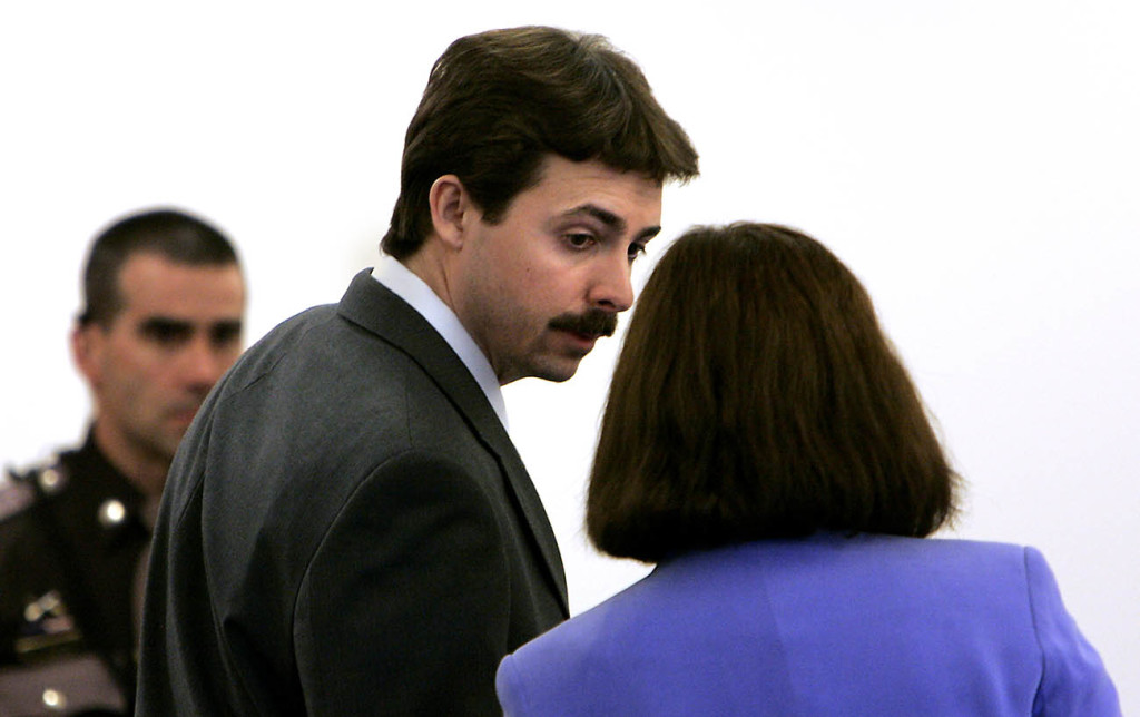 William Flynn talks to his defense lawyer Cathy Green, in Rockingham Superior Court in Brentwood, N.H., in this 2008 photo. The Associated Press