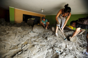 MARCH 24: Residents remove mud and rocks from their house after a massive landslide in Chosica, Peru. Seven people were killed and more feared dead after the landslide buried parts of the town about 18 miles east of Lima, said the head of the National Civil Defense Institute,