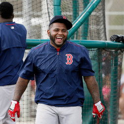 Pablo Sandoval laughs as he jokes with teammates while taking batting practice March 1.