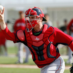 Christian Vazquez throws to third base as he works on rundown drills March 1.