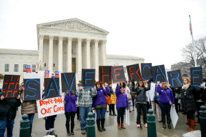 Members of the National Family Planning and Reproductive Health Association rally outside the Supreme Court on Wednesday as the court hears arguments in King v. Burwell, a major test of the Affordable Care Act. The Associated Press