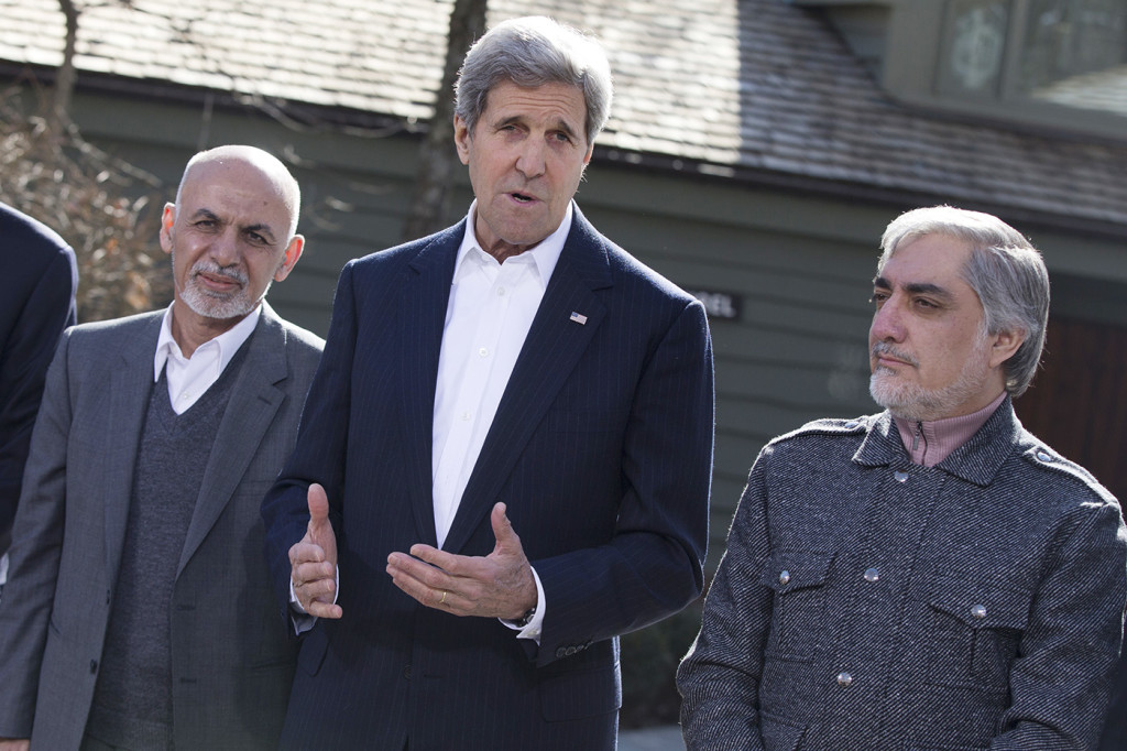 Secretary of State John Kerry speaks before the start of a day of meetings with Afghanistan's President Ashraf Ghani, left, and Afghanistan's Chief Executive Abdullah Abdullah at the Camp David presidential retreat, Monday. The Associated Press