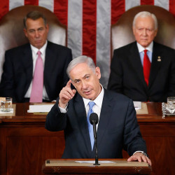 Israeli Prime Minister Benjamin Netanyahu addresses a joint meeting of Congress on Capitol Hill in Washington on Tuesday. Behind him sit House Speaker John Boehner of Ohio, left, and Sen. Orrin Hatch, R-Utah.