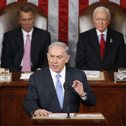 "Israeli Prime Minister Benjamin Netanyahu speaks before a joint meeting of Congress on Capitol Hill on Tuesday. The world must unite to ""stop Iran's march of conquest, subjugation and terror,"" he said. House Speaker John Boehner of Ohio, left, and Sen. Orrin Hatch, R-Utah, listen. The Associated Press"