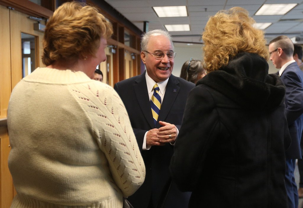 Newly appointed USM president Harvey Kesselman greets attendees of his induction press conference at the Glickman Library at USM in Portland Wednesday. Whitney Hayward/Staff Photographer