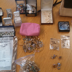 Police display some of the items recovered after the arrests of four York County residents on burglary charges.
