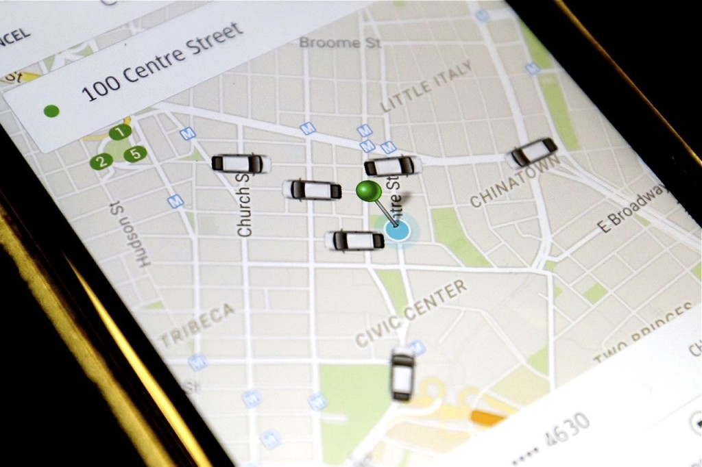 The Uber smartphone app shows the cars available for a pickup in downtown Manhattan Wednesday. The Associated Press