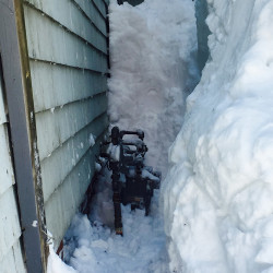 Snow accumulated in this small space between buildings on Munjoy Hill, where the gas meter is located, caused the supply line to break and natural gas to leak Friday, the Portland Fire Department said.