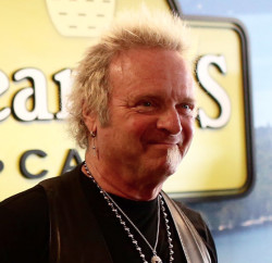 Joey Kramer, the Aerosmith drummer, visits St. Joseph's College in Standish to promote his coffee Thursday.